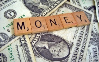 """Creative Commons - Money On A Bed Of Cash"" by 401kcalculator.org is licensed under CC by 2.0."
